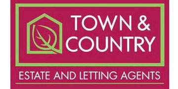 Town & Country* logo